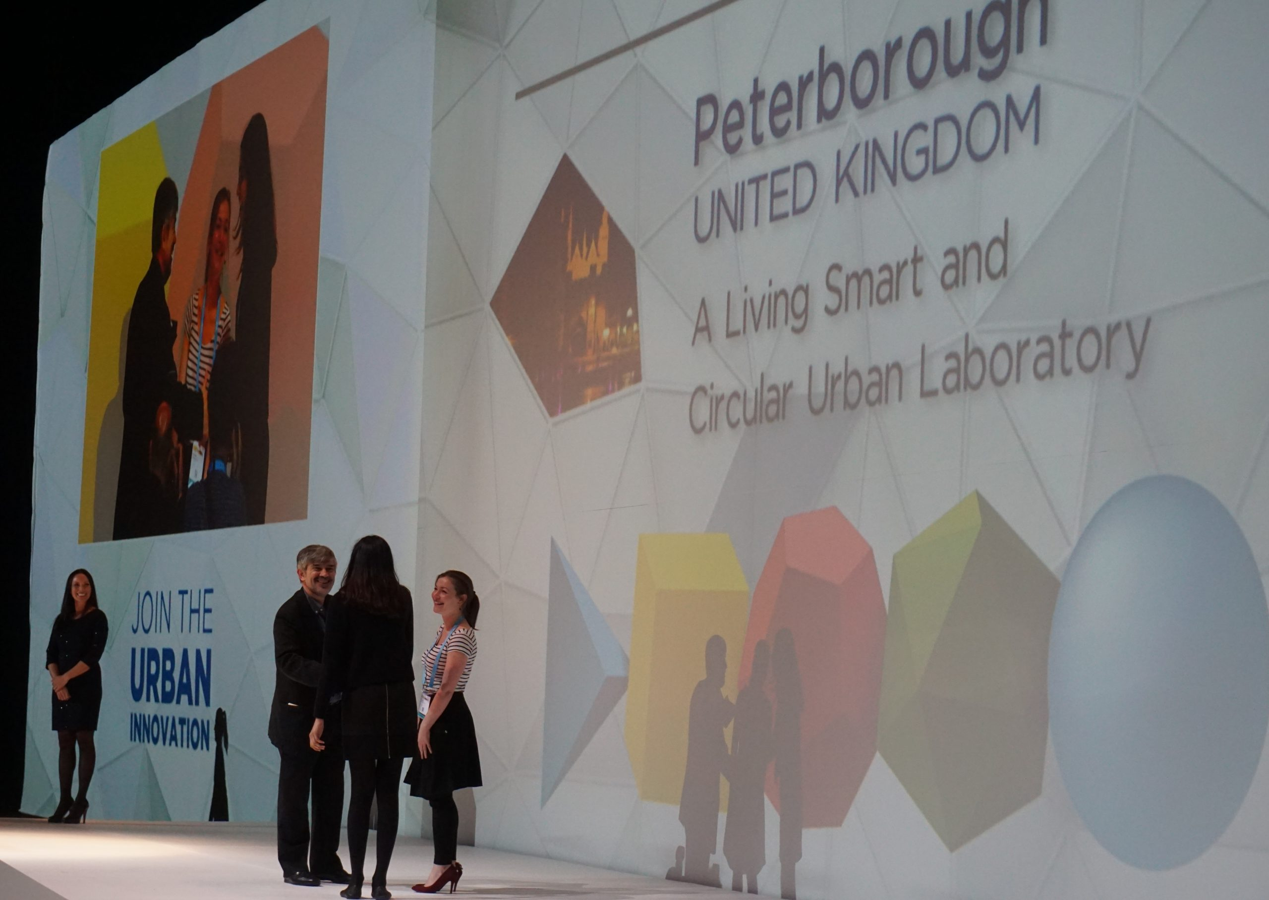 Poppy Rai, Opportunity Peterborough, and Cecile Faraud, Peterborough City Council, accepting Peterborough's Smart City Award 2015